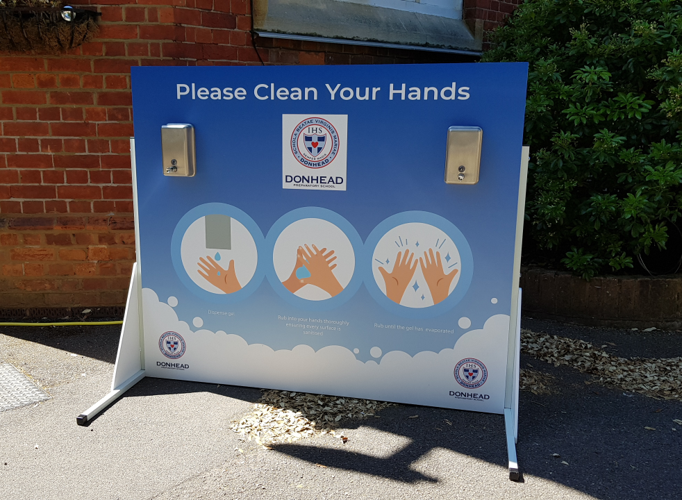 Double sided hand sanitiser station at school entrance